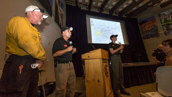Deputy Incident Commander Rocky Opliger, center, speaks to about 100 people during an informational meeting about the Ferguson Fire in Yosemite National Park on Tuesday, July 24, 2018.
