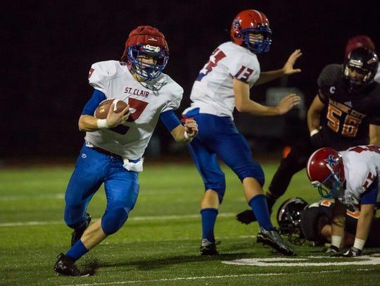 St. Clair's Ethan Mahn runs the ball during a football