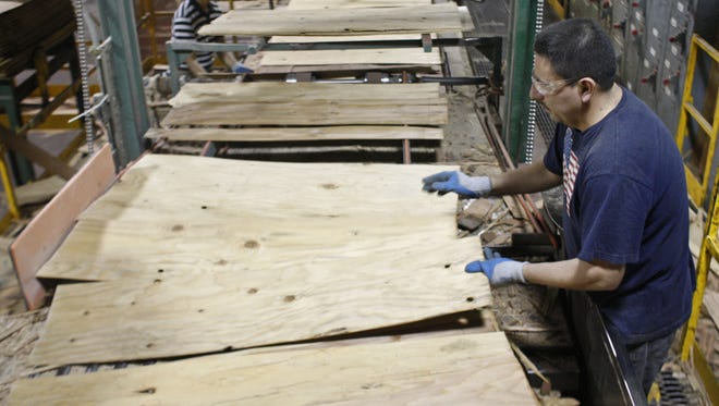 Javier Camacho works on the lay up line at one of the Freres Lumber plywood manufacturing facilities, near Lyons, in 2011.