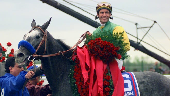 Jockey Gary Stevens and Silver Charm wear the signature roses in the winner's circle after winning the 123rd Kentucky Derby at Churchill Downs in Louisville, Ky., on Saturday, May 3, 1997.