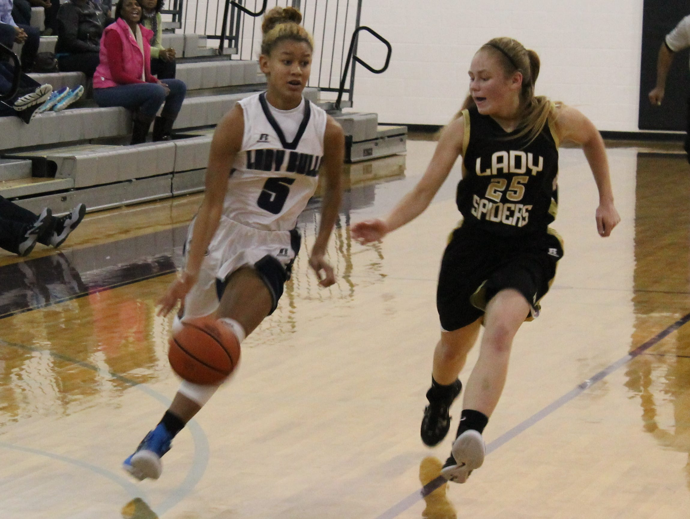 Hickory Ridge's Stacia Means dribbles by a Concord defender in Monday's 51-43 win.