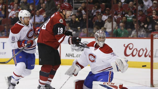 Coyotes' Shane Doan (19) redirects a shot on goal between Canadiens' Greg Pateryn (8) and goalie Carey Price (31) in the first period at Gila River Arena on February 9, 2017 in Glendale, Ariz.