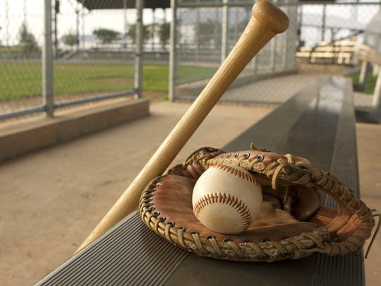 Baseball Bat and Glove in the Dugout