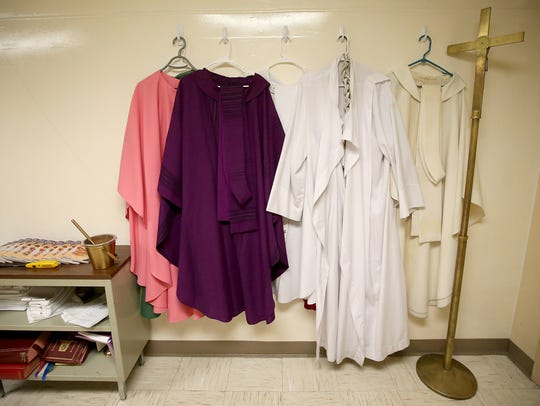 The robes for different denominations hang on the back wall of the chapel aboard the barracks ship being used by the crew of the USS Nimitz while the Nimitz is in dry dock at Puget Sound Naval Shipyard.  