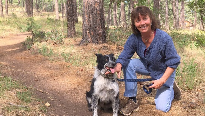 Lincoln National Forest Smokey District Ranger Jodie Canfield  and her dog Nipsy are encouraging people to be responsible with their pets and always keep dogs on a leash while hiking in the forest.