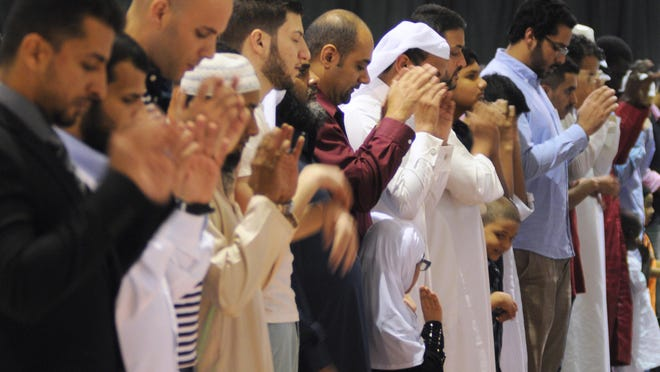 Members of the Islamic Society of Brevard County celebrate Eid al-Adha, the Feast of the Sacrifice, at the Melbourne Auditorium.