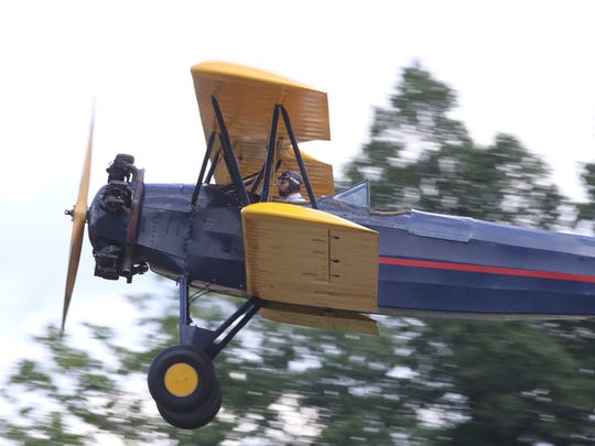 """In this Aug. 8, 2015, file photo, volunteer and pilot Alex Jameison, 22, of Rhinebeck flies a 1942 Fleet Finch 16-B during the """"Meet the Fokkers Weekend"""" at Old Rhinebeck Aerodrome in Red Hook."""