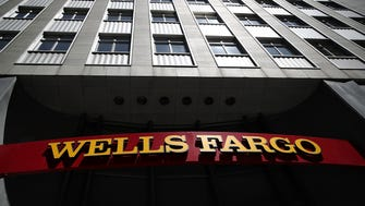 File photo taken in 2017 shows a Wells Fargo sign outside one of the bank's locations in San Francisco, California