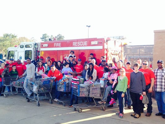 Firefighters Give Christmas Gifts To Children