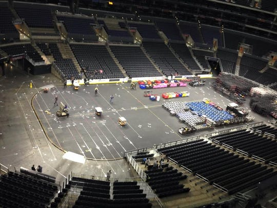 Workers at the Staples Center in Los Angeles, Calif. build the stage for the 57th Grammy Awards.