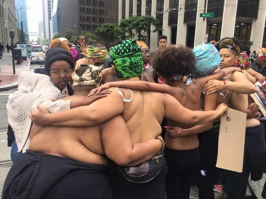A group of protesters rallying behind the 'Black Lives