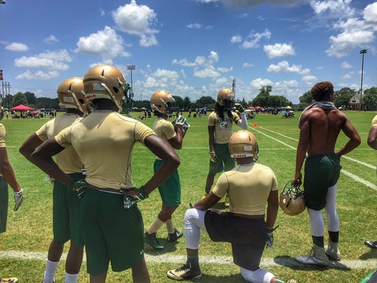 The Lincoln football team rests momentarily in between games during Saturday's 7-on-7 tournament at FSU.