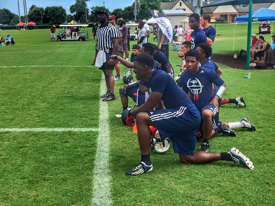 Wakulla receiver Keith Gavin takes a breather and watches his team during FSU's 7-on-7 tournament in June.