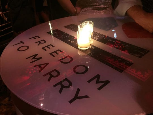The Freedom to Marry logo is featured on table tops