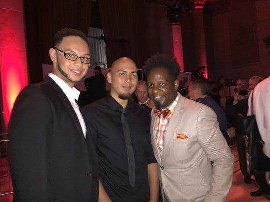 Julius Owens, left, his husband, Chris Martinez, middle,