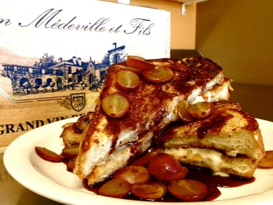 The Wine Country French toast from Perk Eatery is stuffed with French Brie and garnished with roasted red grapes and red wine rosemary syrup.
