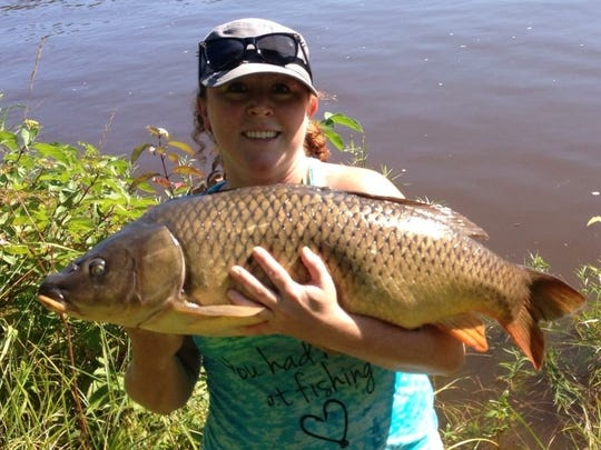 Corrina Beaner from Superior with this giant carp caught