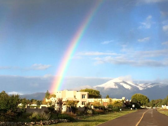 With a snow-covered Sierra Blanca Peak in the background,
