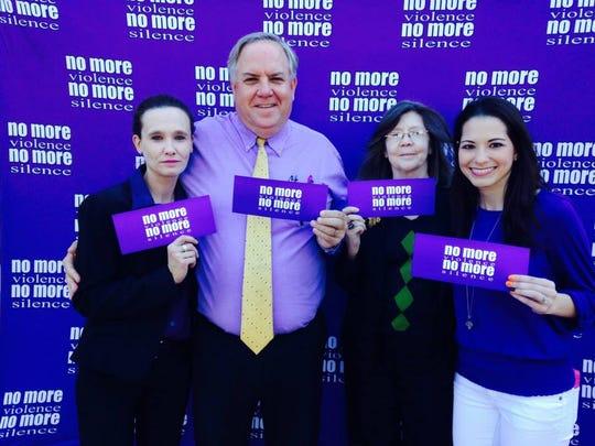 Staff members wear purple in honor of Domestic Violence
