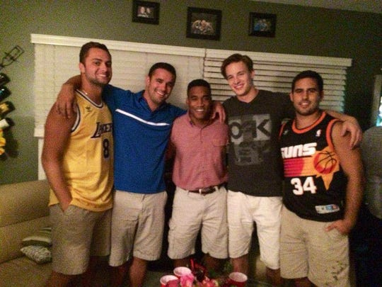 Josh Nolen (center) is pictured with good friends (from