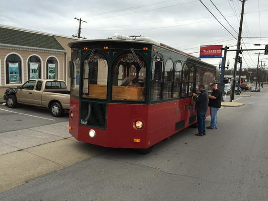 The downtown Holly Trolley helps keep shoppers out of the cold as they visit various businesses around downtown Murfreesboro.