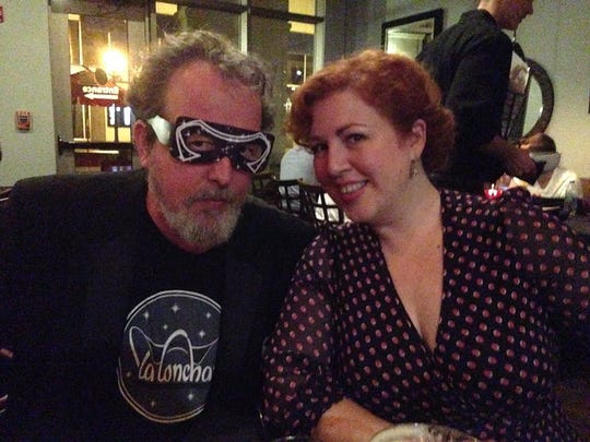 Columnist Mark Hinson dons an Orion-style mask for English documentary director Jeanie Finlay during her visit to Tallahassee.