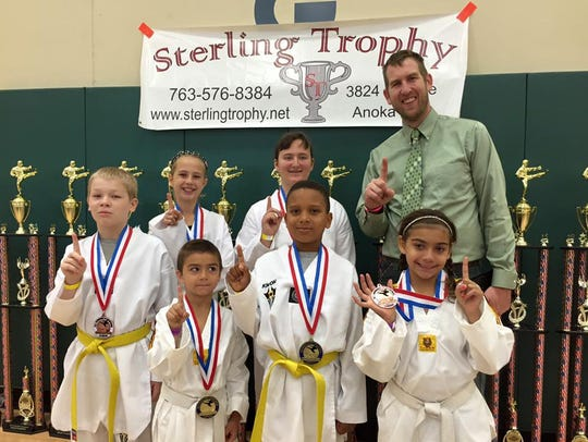 Representatives of the Five Rings Taekwondo Team .