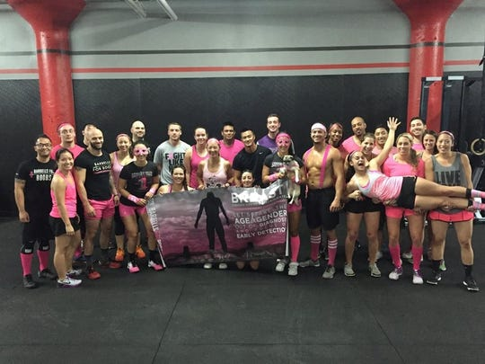 "CrossFit Stealth, a New Brunswick-based training facility that specializes in group functional fitness, conducted a ""Barbells for Boobs"" fundraiser on Oct. 25 to raise funds for breast cancer awareness programs. As a team, participants, shown her, raised more than $6,000. For more information, visit www.barbellsforboobs.org."