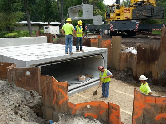 Crews install culverts along Lynwood Drive this fall.