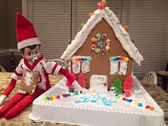 Buddy eats the gingerbread house.