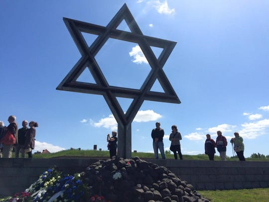 The Jewish community gathered around the Star of David after the ceremony commemorating the 70th anniversary of the liberation of the Thereseinstadt concentration camp and recited Kaddish. Catherine Greer, a Ph.D. student at the University of Tennessee at Knoxville, attended the event. She will be speaking in Jackson this weekend.
