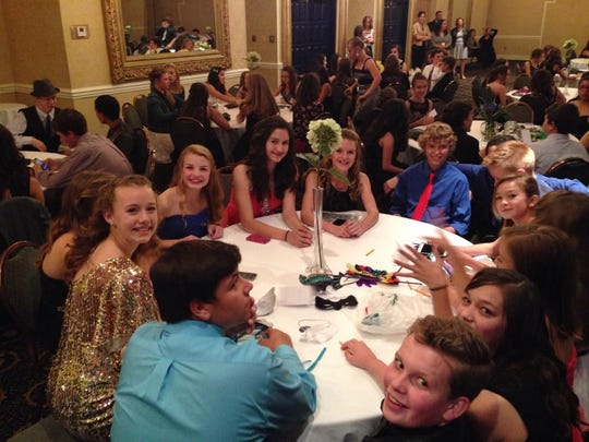 """Las Cruces Junior Cotillion participants practice social skills at a recent dance. It's a """"safe environment"""" that includes retro features like dance cards, which are popular with kids, organizers said."""