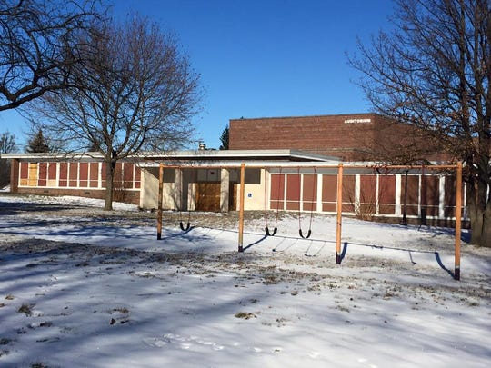 The auditorium at the former Michigan School for the Blind site will eventually be torn down. An Indianapolis developer plans to keep several existing buildings on the site for a residential housing project.