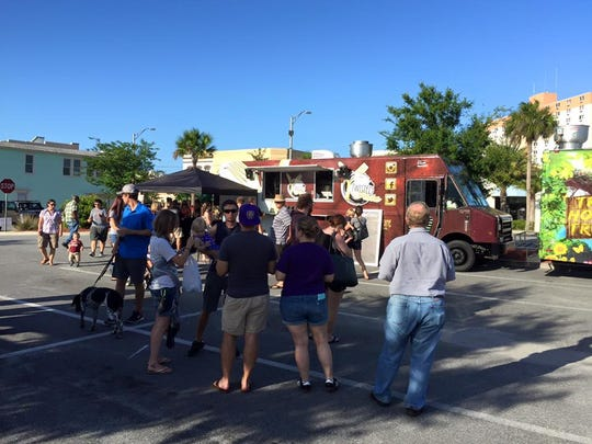 Public gather for a food truck event in Titusville