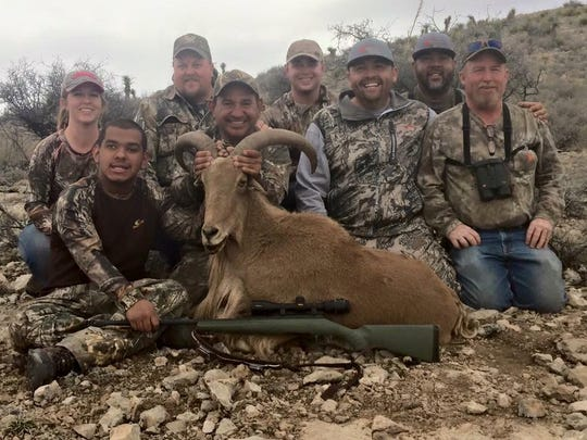 Alonzo Fasa, 16, left, and his group of mentors following a hunt on a ranch just outside of Roswell.