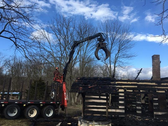 The Negley log cabin at Conococheague Institute was torn down Monday after an early morning fire.