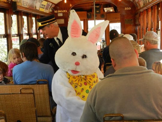 The East Bunny mingles with guests inside a trolley
