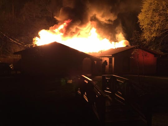 The Reservoir Fire Department battles a hourse fire early Sunday morning.