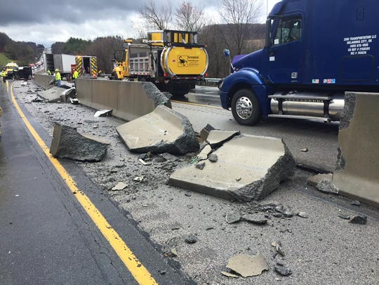 The jersey barrier on Interstate 83 was damaged in