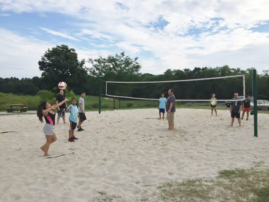 Participants play volleyball during the 2015 Spring