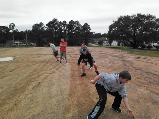 Member of the Mason High School baseball team made do with an empty field while they were stuck in Ashburn, Georgia.