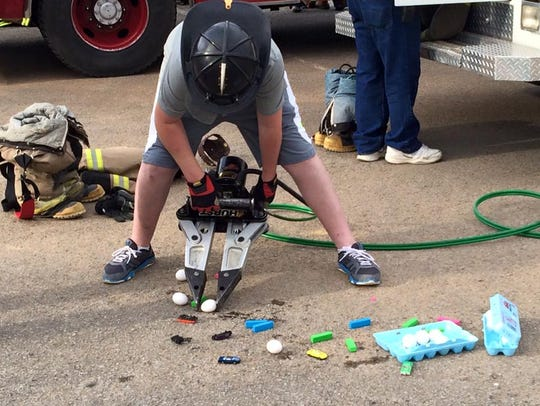 Kids learned how the jaws of life machine is used.
