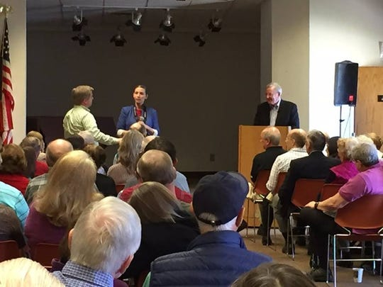 Steve Forbes takes questions from the audience at the Bridgewater Library.