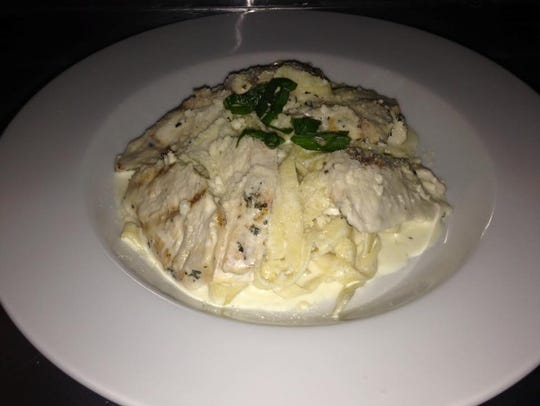 Rosemary chicken alfredo with homemade noodles, served