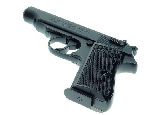 635975140666359316-handgun.jpg