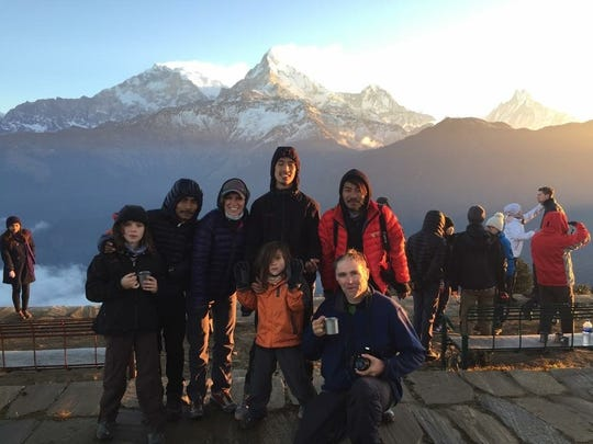 Professor Whizzpop (front-most) and family in Nepal, standing in the foreground of the Annapurna mountain range.
