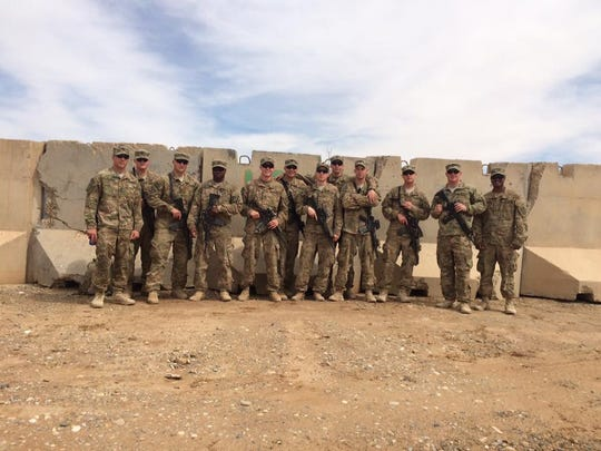 On the far right, Army First Lt. Varun Hollabbi with his platoon in Afghanistan in 2015