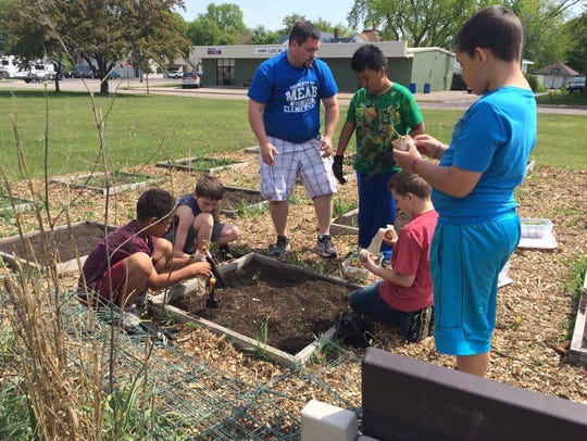 Dylan, Clayton, Andrew, Kevin, Isaiah, D'Angelo planting