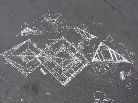 """Chalk sketches of the """"Catacomb of Veils"""" are drawn onto the ground at the San Francisco build site."""