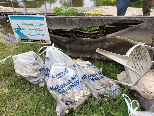 Bags of litter and debris collected during a June 4 cleanup of the Manitowoc River.